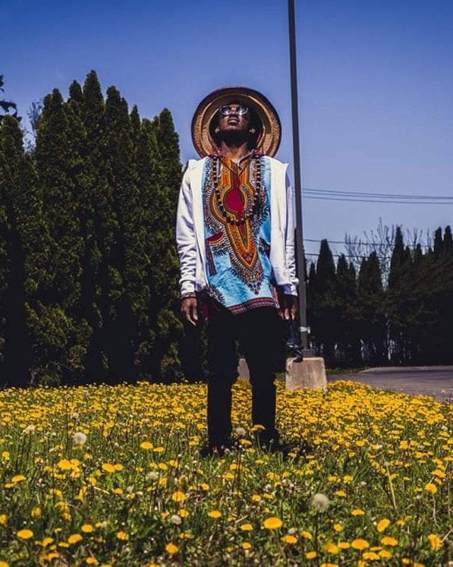 Dandelions and Man with a Mexican Hat